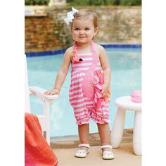 Sweet pink striped bubble features clever elastic wrap-around flamingo applique with nylon spandex feathers, metallic ric-rac accent and Velcro closure. Elastic leg opening and inner leg snap closure.
