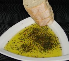 Carrabba's Bread Dipping Spice Recipe!   1 tablespoon minced basil, 1 tablespoon chopped parsley, 1 tablespoon minced garlic, 1 teaspoon dried thyme, 1 teaspoon dried oregano, 1 teaspoon ground black pepper, 1/2 teaspoon kosher salt or 1/2 teaspoon ground sea salt, 1/2 teaspoon chopped rosemary, 1/4 teaspoon crushed red pepper flakes, 1/2 teaspoon olive oil, 1/8 teaspoon fresh lemon juice