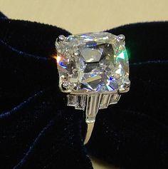 Art-deco ring, platinum, one antique cushion cut diamond weighing 5,05 cts, baguette cut diamonds, circa 1930
