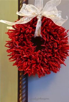 chili pepper ristra with a Christmas ribbon, changing it up from the usual raffia to make it holiday festive!