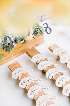 whale escort cards, photo by Beaux Arts Photographie http://ruffledblog.com/rancho-palos-verdes-wedding #escortcards #seatingchart #weddingideas