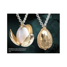 COLGANTE HARRY POTTER HUEVO DE ORO … Producto de calidad y con licencia., El huevo de oro fue ganado por Harry Potter en la primera prueba del Torneo de los 3 Magos.