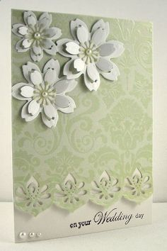 handmade wedding card ... pale green and white ... three layered die cut flowers .. lovely brocade design in tone on tone color ... elaborate edge punch ... beautiful card!!