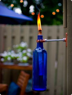 DIY Ideas for the Outdoors - Recycled Wine Bottle Tiki Torch - Best Do It Yourself Ideas for Yard Projects, Camping, Patio and Spending Time in Garden and Outdoors - Step by Step Tutorials and Project Ideas for Backyard Fun, Cooking and Seating http://diyjoy.com/diy-ideas-outdoors