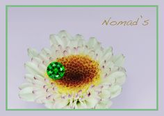 Demantoid Garnet from Russia, very rare nowadays. Just one carat but the color and brilliancy make it a fabulous gem.