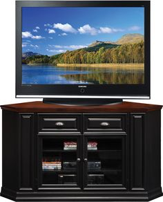 Put the corner at the forefront of your entertainment room with the Leick Home Riley Holliday 62 in. Corner TV Console - Black and Cherry . Entertainment Wall Units, Home Entertainment Furniture, Black Corner Tv Stand, Cherry Tv Stand, Corner Tv Console, Console Cabinet, Flat Screen Tv Stand, Living Room Wall Units, Television Stands