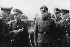 Dr Enno Lolling (2nd from left) was the director of the Office for Sanitation and Hygiene in the Inspectorate of Concentration Camps. Among his other bestialities, he ordered prisoners killed and their tattoos preserved to send to Berlin. He also authorized experiments to shrink cadaver heads. He thankfully committed suicide in 1945. On the right of the photo is Rudolf Hoess, the notorious Auschwitz commandant.
