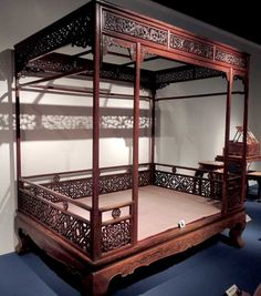 Chinese Ming Dynasty Furniture- a bed was not just for sleeping. An adjustable bed made of cane should be light enough to be moved around