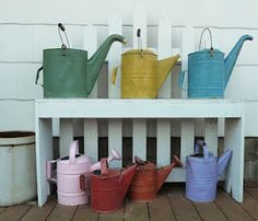 I only have a few....need to run around now that it's the season to purchase watering cans!
