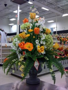 Spring Floral arrangement Hotel Flower Arrangements, Creative Flower Arrangements, Funeral Arrangements, Silk Floral Arrangements, Bouquets, Hotel Flowers, Easter Flowers, Church Flowers, Silk Flowers