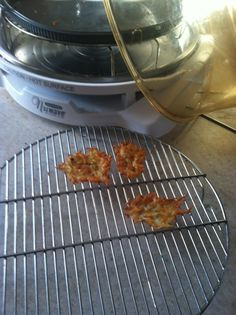 Cathy R. shared a great recipe for Parmesan Crisps that anyone can make using the NuWave Elite! She told us that these are perfect toppers for French onion soup!    She placed 1 tablespoon of grated parmesan cheese in the Silicone Pizza Liner. Then, she placed the liner on the 3-inch rack and cooked at 420°F for 2-3 minutes. Then, using a spatula, she transferred them to a cooling rack before enjoying!