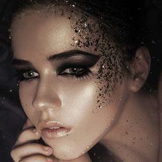 Avant-garde Eye Makeup with Black Eyeshadow and Glitter