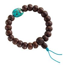 DharmaCrafts-Dark bodhi seeds are strung with elastic and accented with a large bead of Tibetan turquoise.