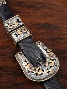 Clint Orms Pecos buckle with filigree and 2 colors of 14k gold and sapphires.  Gorgeous!  Seidel's Saddlery.  307-587-1200.  www.seidelsaddlery.com