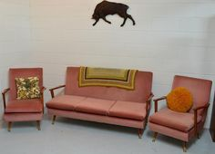 Very retro ~ crotcheted rug, colourful patterned cushions and the wall-hanging. Very retro.