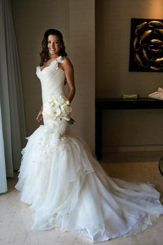 Custom made Mark Zunino gown purchased at Kleinfeld NYC in 2015. Mermaid style, with single spaghetti strap. Leaf and flower applique throughout dress and matching strap.  |  Tradesy is the leading used luxury fashion resale marketplace | 100% AUTHENTIC, OR YOUR MONEY BACK | We have a zero-tolerance policy for replicas. Our authentication rate is best in the industry (Stronger than eBay, ThreadUp, The RealReal, Poshmark, Vestiaire, and Worthy), our smart technology automatically detects and…