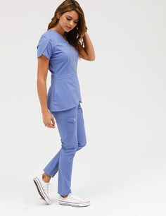 The Tulip Top in Royal Blue is a contemporary addition to women's medical scrub outfits. Shop Jaanuu for scrubs, lab coats and other medical apparel.