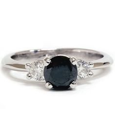 Black diamond engagement ring! if only the colors were switched.