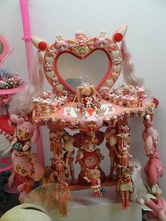 This frightens me. It appears to be a shrine to Chibiusa from Sailor Moon. Why someone felt the need to put her hairdo on a miniature vanity table is beyond me.