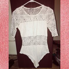 ✨Paisley lace white bodysuit✨ BRAND NEW from Charlotte Russe! Paisley print see through bodysuit! Size large true to size! Crotch part snaps together.. only looking to sell Charlotte Russe Tops