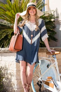 Country girl chic, this little blue dress is made of a cotton blend that moves effortlessly as you do. It has a v neck front and back with striped crochet detailing along the top half that stuns.