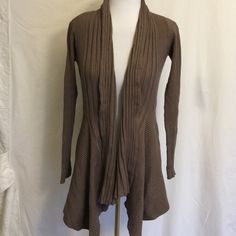 """25% off($7) Cute Wrap ribbed Cardigan Tan XXI Cute!! Wrap ribbed Cardigan - Tan/mauve color -  Forever - 21 small - gently used, good condition..80% viscose 20% nylon.  Length 27"""", sleeve under arm 18"""" Forever 21 Sweaters Cardigans"""