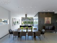 On Top of TriBeCa: Penthouse by Steve E. Blatz | In the dining area, Dordoni's chairs surround a custom table topped in walnut and brass. #design #interiordesign #interiordesignmagazine #architecture #dining #table