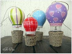 lightbulb hot air balloons. would make a cute mobile or Christmas ornaments. Could be cute for 31 conference!