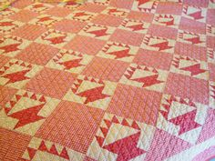 """Cactus  Basket pattern quilt that is also called """"Cake Stand"""".  The """"baskets"""" are a popular double pink colored fabric and the alternate blocks a nice small checked gingham fabric. The background on the baskets is a small print shirting fabric. The small blocks are only 5 1/2 inches in size."""