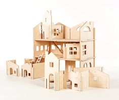 Build Your Own Wood Dollhouse with Towers // di manzanitakids