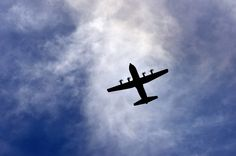 C-130J Super Hercules flies overhead as it prepares to land at Creech Air Force Base, Nev., during Joint Forcible Entry June 21, 2014. The joint airdrop exercise is designed to enhance service cohesiveness between the U.S. Army and Air Force. It gives both services an opportunity to properly execute large scale heavy equipment and troop movement. (U.S. Air Force photo by Tech. Sgt. Nadine Barclay/Released)