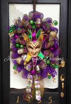 Large Oval Jester Mardi Gras Wreath with Fleur de Lis ribbon, ornaments, and decorative picks Jayne's Wreath Designs on FB