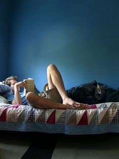 By Krmmnn, via Flickr. Man reading with his cat on a lazy afternoon. Such great composition. #photography