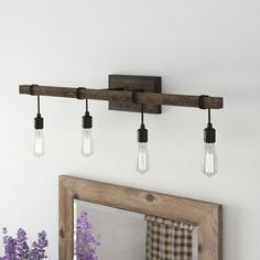 Simple, cottage style is yours with the unique Vanity Light. It features little more than bare bulbs suspended from cords wrapped around the bar-shaped structure, finished in Durango, but this minimal look makes a big impact. Rustic Vanity Lights, Farmhouse Vanity Lights, Modern Farmhouse Lighting, Modern Country, Best Bathroom Vanities, Single Bathroom Vanity, Bathroom Faucets, Bathrooms, Bathroom Ideas