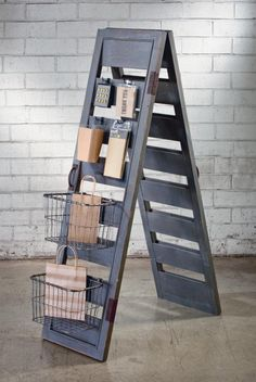 Add a rustic element to any space or display with our Shutter Ladder Display. This wooden piece features a blueish grey finish and is perfect for hanging towels, linens, or for display many other items. Ladder measures 56h x 16.25w x 33d Embellish this piece with other accessories using our 2 Industrial Baskets measuring 8h 12w x 9.5d and 12 Industrial Hooks measuring 3.5in long We can customize this item to only include additional hooks or baskets to meet your needs. Good for…