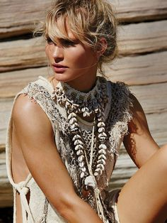 Into the Wild Necklace | Handmade in Southern California, this braided leather chain necklace features a statement feather pendant and leather fringe.