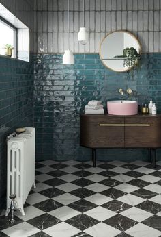 eclectic boho bathroom with teal glazed wall tiles in metro brick tile layout. Mid century modern wash basin with pink sink and gold basin taps. Black and white floor tiles and a victorian radiator completes the look Kitchen Tiles Design, Bathroom Tile Designs, Bathroom Interior Design, Interior Modern, Boho Bathroom, White Bathroom, Small Bathroom, Blue Bathroom Tiles, Downstairs Bathroom