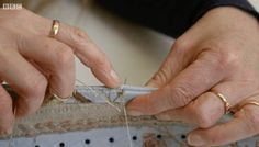 """Costumer Harriet Waterhouse demonstrates a stitching technique used in an 18th-century pair of stays in Episode 6, """"Marie Antoinette."""""""