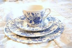 vintage blue dishes.  English Ironstone Transferware.  I think it's pattern # EIT47 on replacements.com.  They have the same pattern in red #EIT16 that looks good.