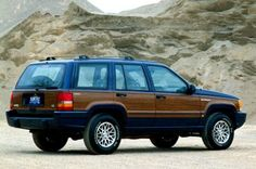 1993 Jeep Grand Wagoneer. America's favorite SUV, clad in wood and furnished with cushy leather seats. If you have to drive an SUV, this is about as good as it gets.