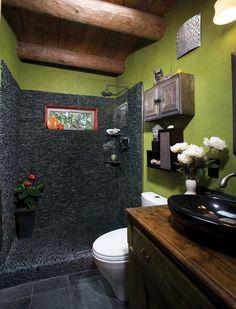 Remodeled bathroom - Charcoal black standing pebble tile on shower wall, Charcoal black pebble tile in shower pan floor