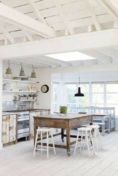 White open beam vaulted ceiling. Farmhouse kitchen. Love that island/table!