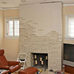 Partially painted brick fireplace.using a base coat, drying then adding another color for accenting/variation