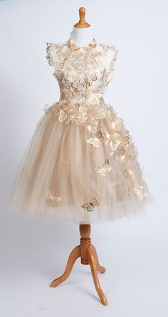 The Gold tulle butterfly dress made with the Cricut Explore.