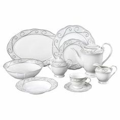"""Featuring a scrolling silver-hued motif and gently scalloped edges, this porcelain dinnerware set provides service for eight guests.  Product: (8) 10.5"""" Dinner plates (8) 7.5"""" Salad plates (8) 8.5"""" Soup bowls (8) 8 Ounce tea cups (8) 5"""" Tea saucers 14"""" Platter Serving bowl Teapot and lid Creamer Sugar bowl and lidConstruction Material: PorcelainColor: White and silverCleaning and Care: Dishwasher safe"""