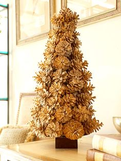 Bleached Beauty...Make this pinecone tree stand out by softening its rugged look. Fill a bucket with bleach, add the pinecones, and let them soak overnight. Then hot-glue the bleached pinecones to a grapevine cone that's glued to a weighted box.