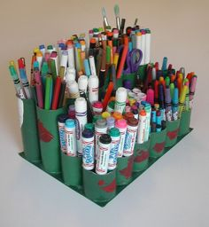 crayon/marker caddy made from recycled toilet paper rolls.  My kids will love doing this! It might not last very long, but if it keeps the markers off the floor, even for a few days, I celebrate it, sir.