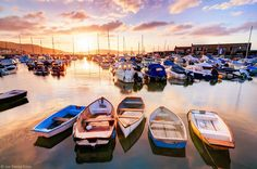 Beautiful Sunrise, Boats at Lyme Regis Harbour, Dorset, England - Lyme Regis is a coastal town situated 25 miles west of Dorchester and 25 miles east of Exeter, at the Dorset-Devon border. The town is nicknamed The Pearl of Dorset and is noted for the fos St Just, Places In England, Lyme Regis, Dorset England, Jurassic Coast, Photography Classes, Photography Ideas, Beautiful Sunrise, Exeter
