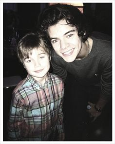 Apparently Harry with his hair pushed back, with a child, some red eye, and captured on a low quality camera is my kryptonite.