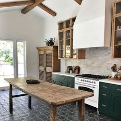 15 Farmhouse Style Decor Ideas to Get You Started Love this reclaimed wood kitchen island table. Green kitchen cabinets, wood beam ceiling, and gray tile kitchen floor. Reclaimed Wood Kitchen, Kitchen Interior, Home Decor Kitchen, Kitchen Flooring, Kitchen Trends, Kitchen Remodel, Black Tiles Kitchen, Reclaimed Wood Kitchen Island, Kitchen Design